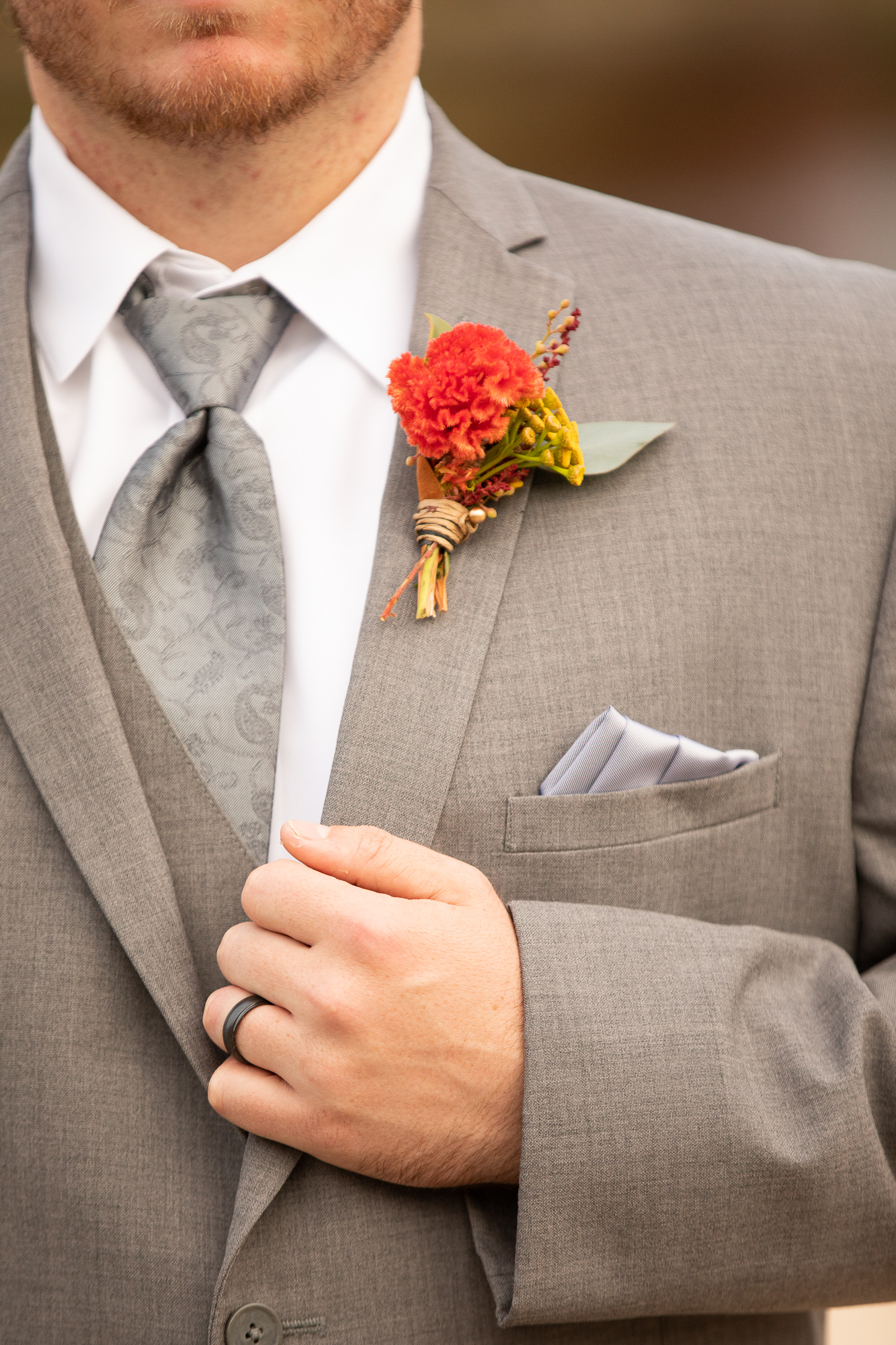 Cable Creations suit at The Gathering Place wedding with Posies by Patti boutonniere.