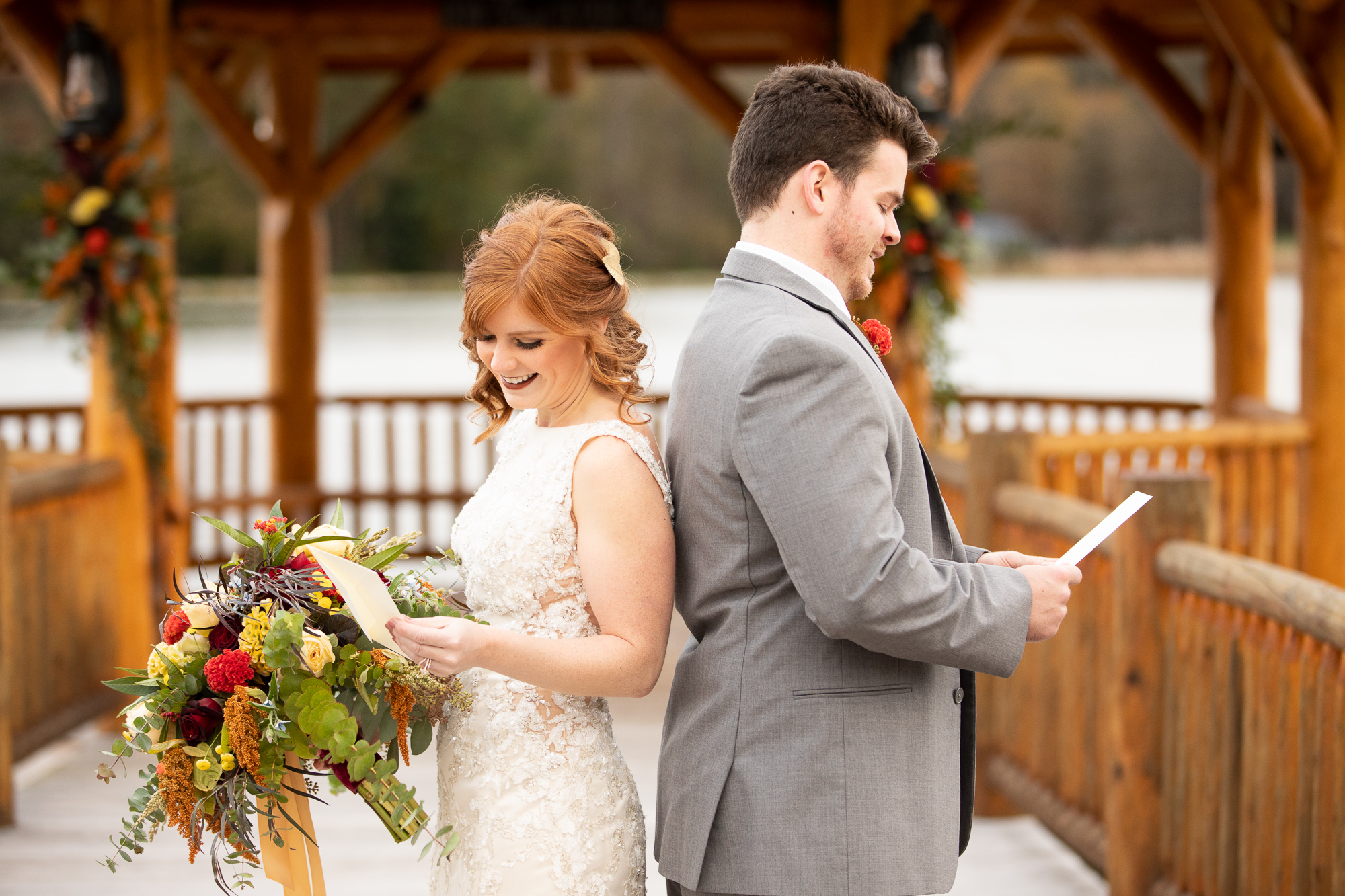 Bride and groom exchanging Wood & Grace love letters at autumn wedding styled shoot.