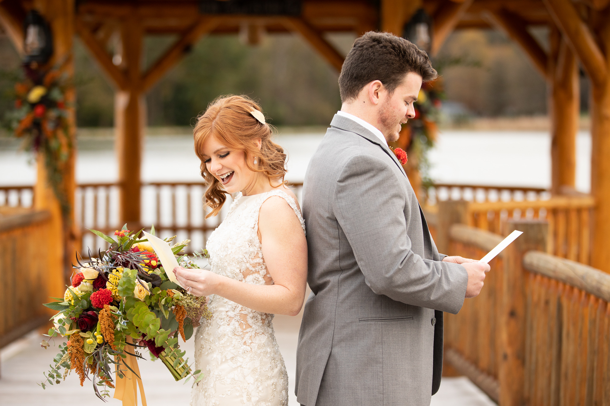 Bride and groom exchanging Wood & Grace love letters at autumn styled shoot.