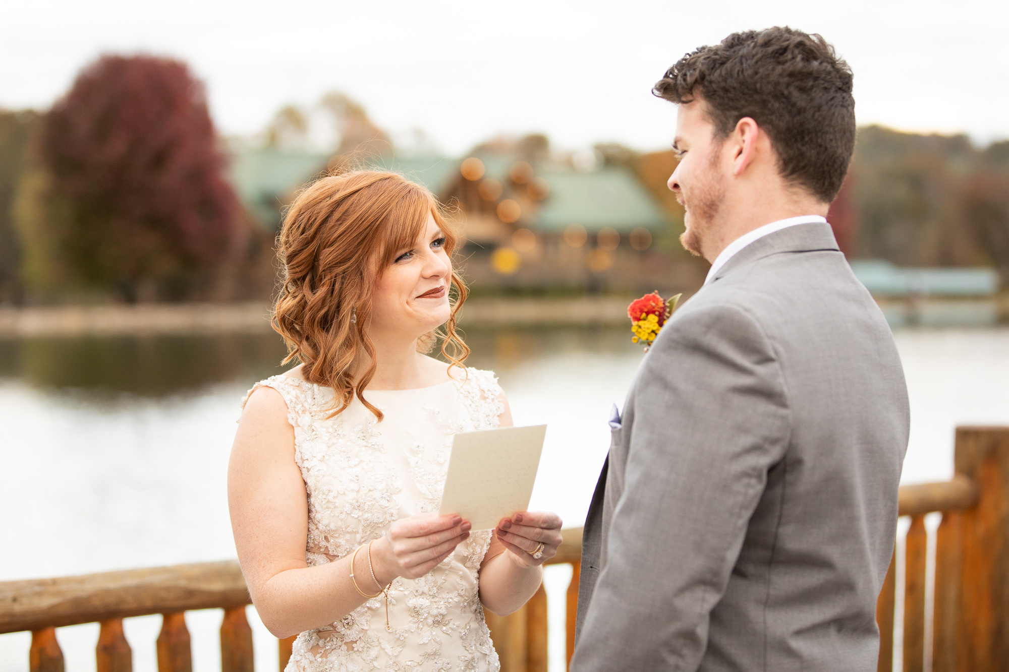 Bride and groom read vows at autumn styled shoot at The Gathering Place.