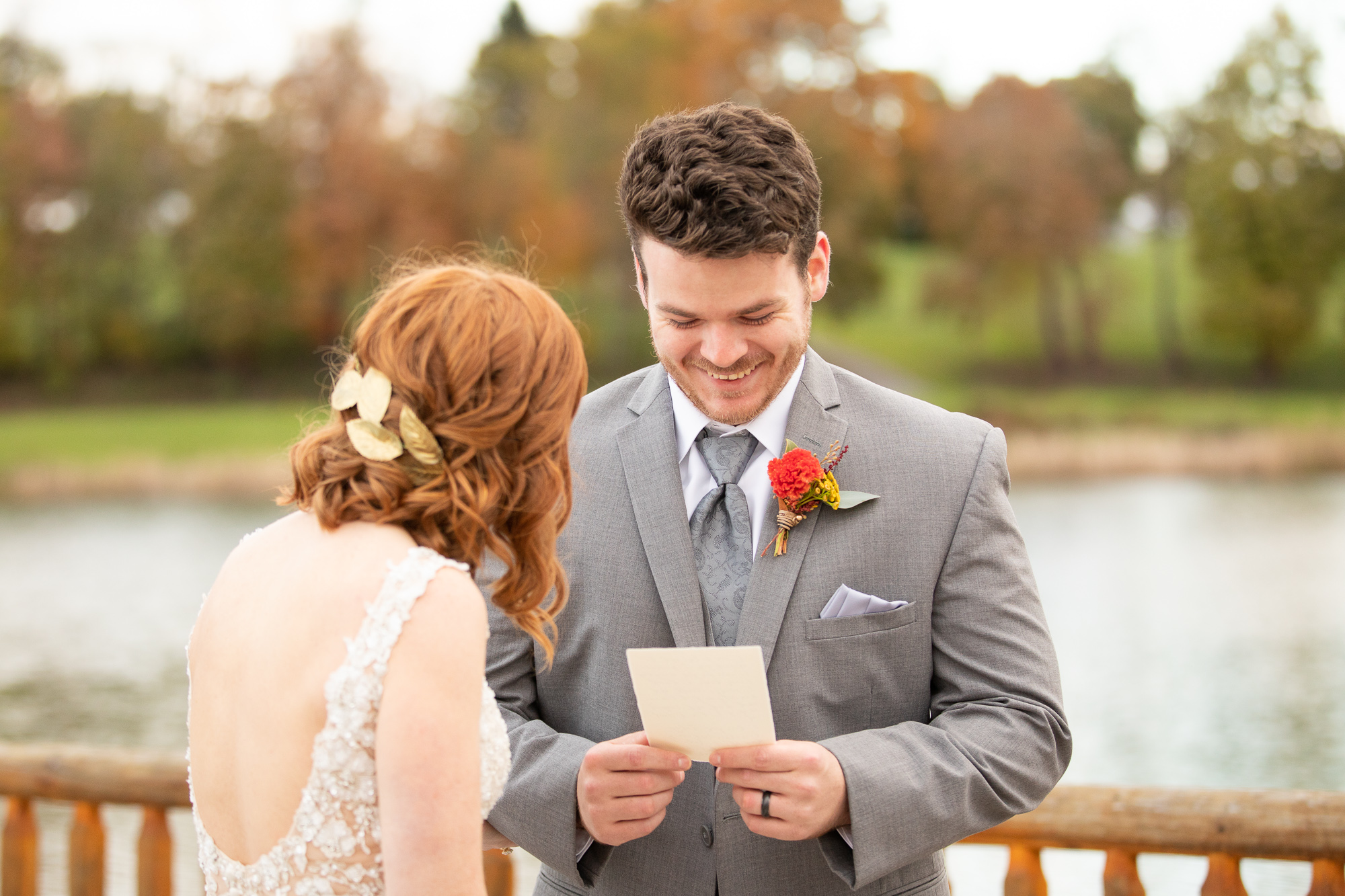 Bride and groom reading wedding vows at autumn styled shoot.