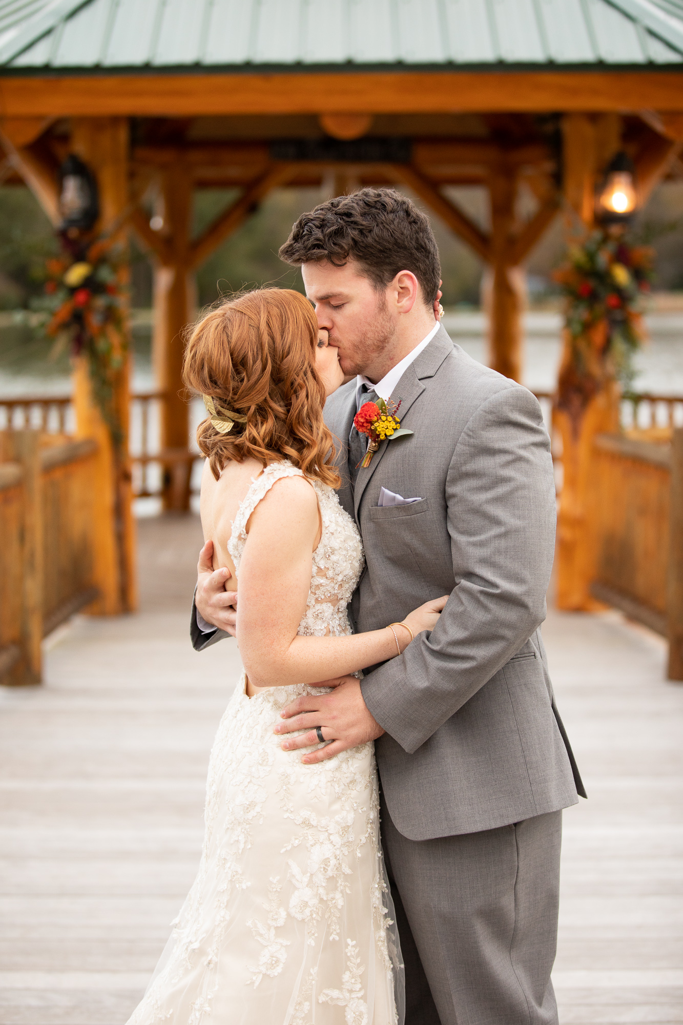 First kiss of bride and groom at autumn styled shoot wedding.