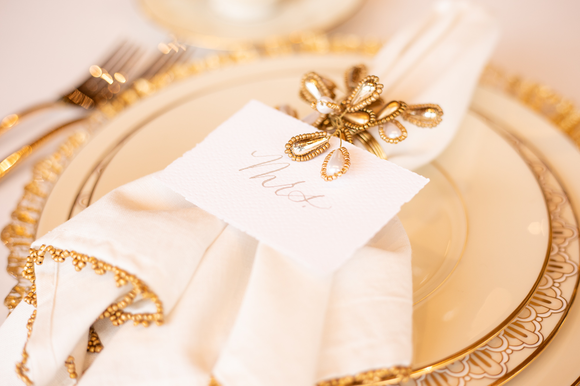 Wood & Grace sweetheart table place cards and Chelsea Party Center wedding table settings.