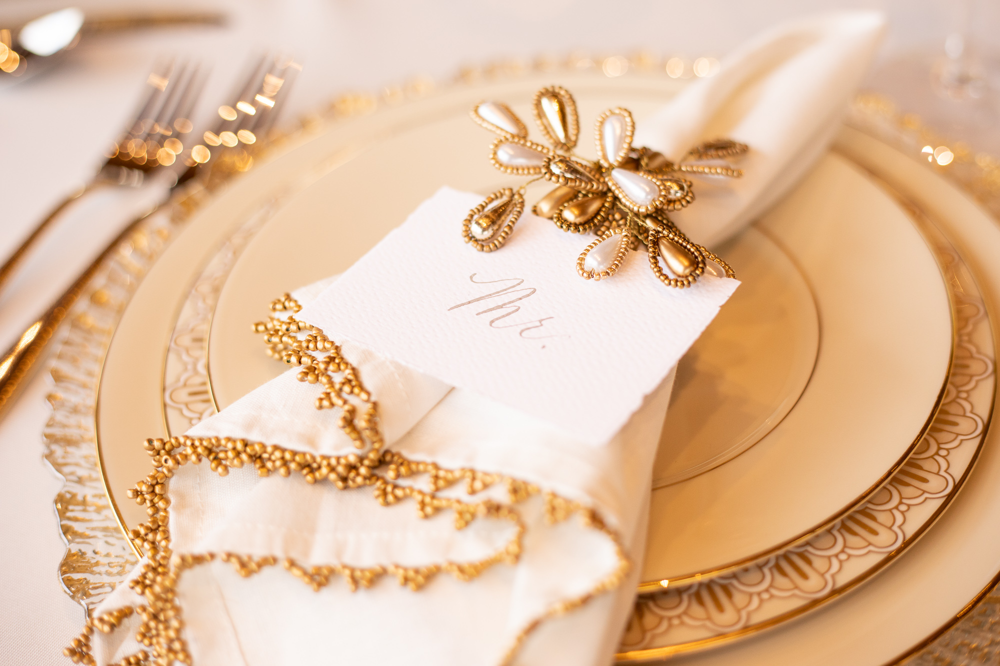 Wood & Grace place cards and Chelsea Party Center sweetheart table settings.