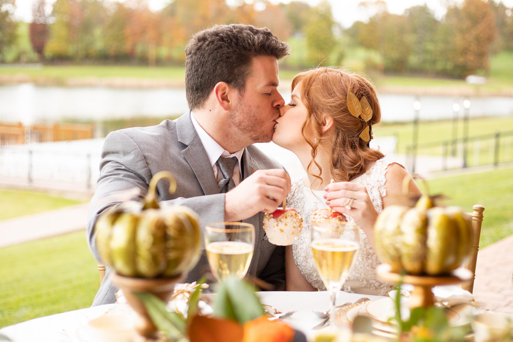 Bride and groom at autumn wedding styled shoot sweetheart table. Nizhoni Bakery.