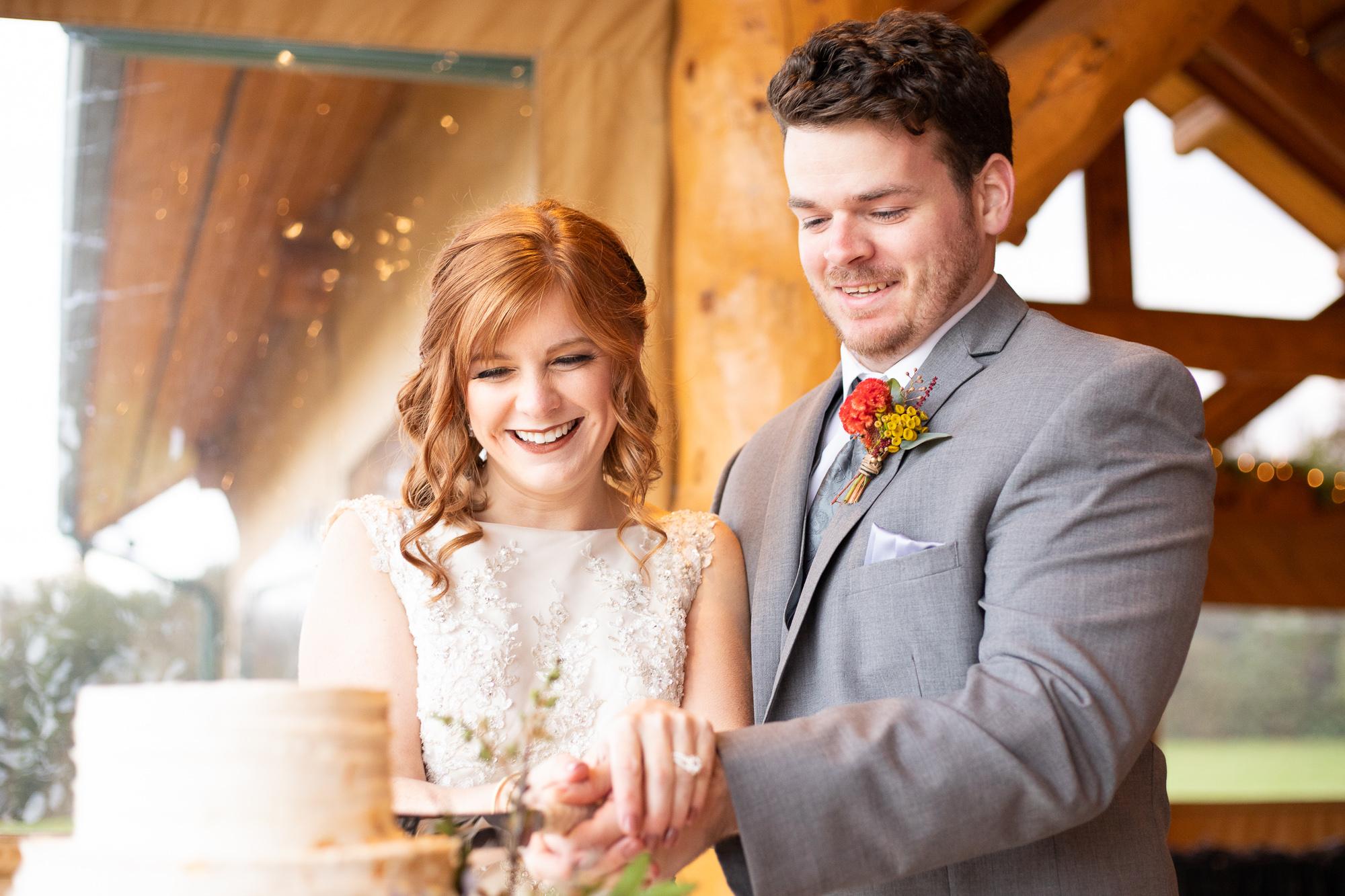 Bride and groom cutting Nizhoni Bakery wedding cake at autumn wedding styled shoot.