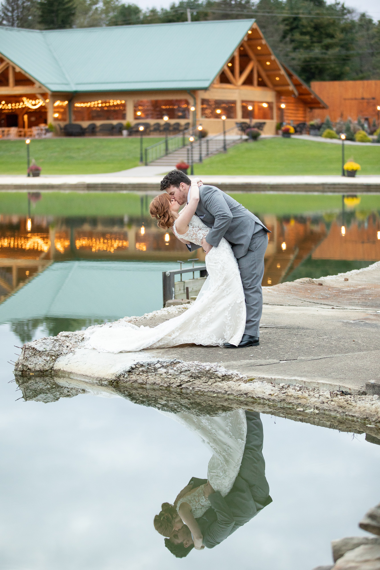 Bride and groom reflected in the water at The Gathering Place autumn styled shoot.