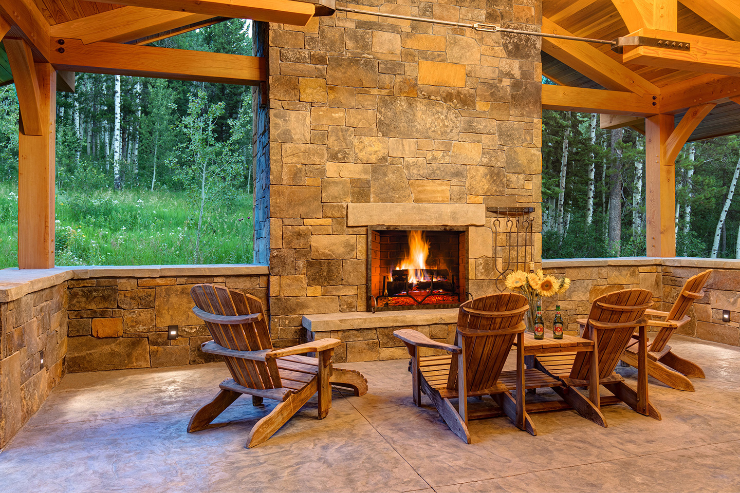 Outdoors fireplace with Adirondack chairs