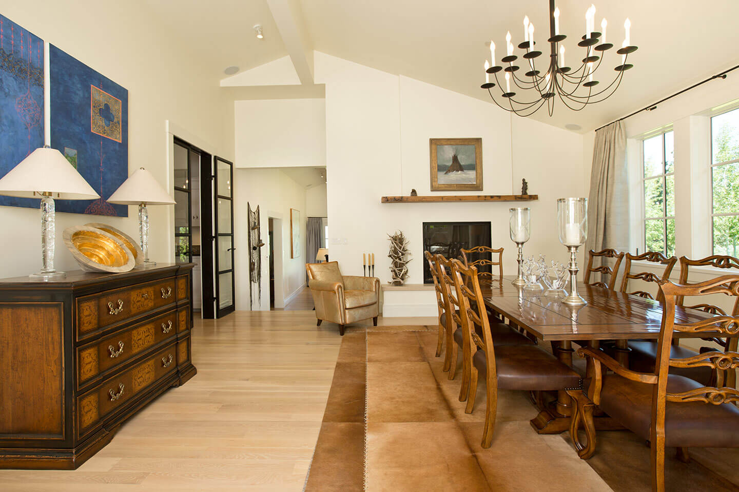 Dining room with antique furniture and leather rug