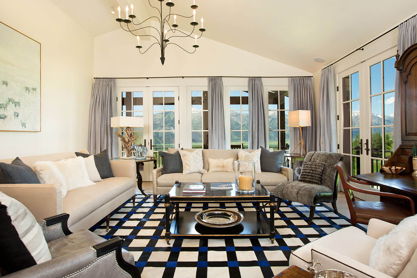 Classic living room with pattern rug and chandelier