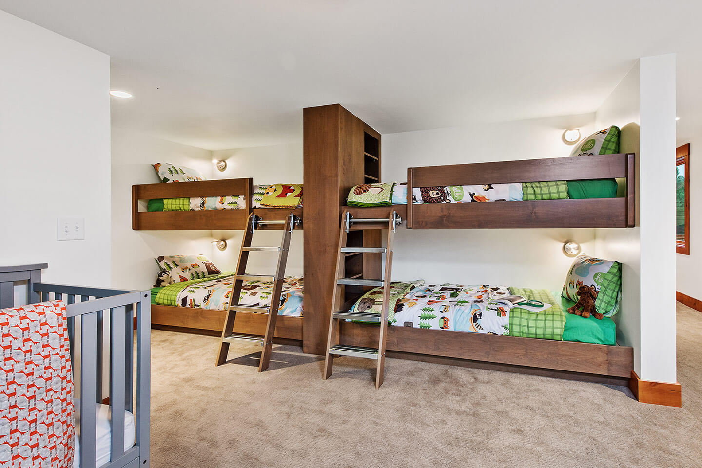 Children's bedroom with custom-designed bunk beds and crib