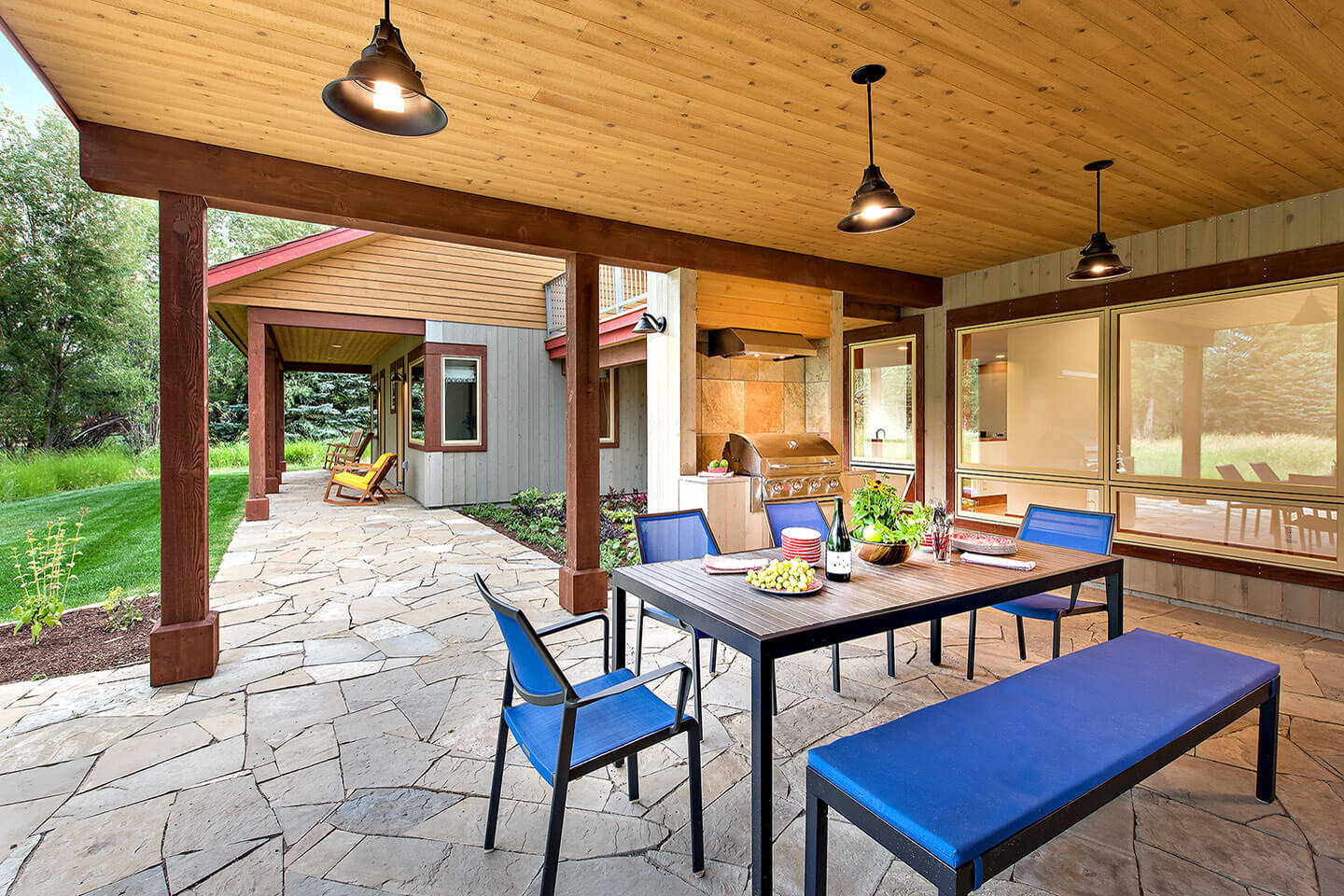 Stone patio and covered outdoor dining area