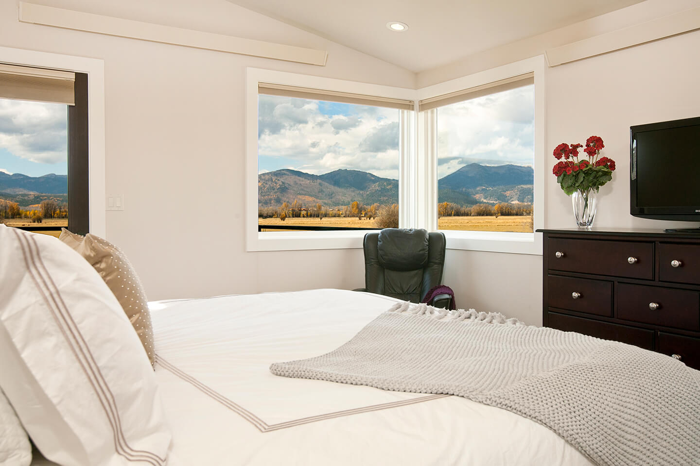 Bedroom with two corner windows