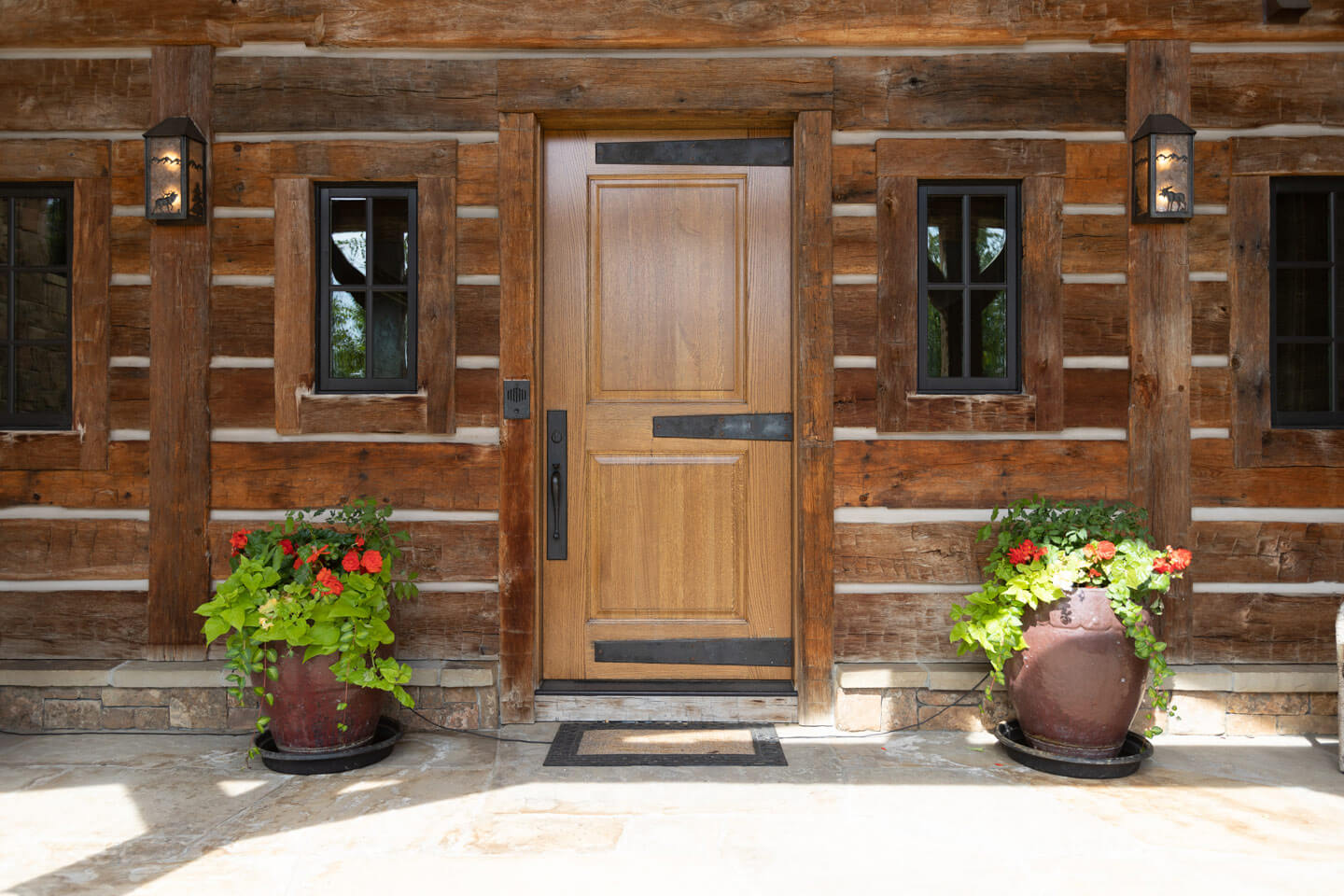 Residence entrance with alder wood door and wrought-iron hinges