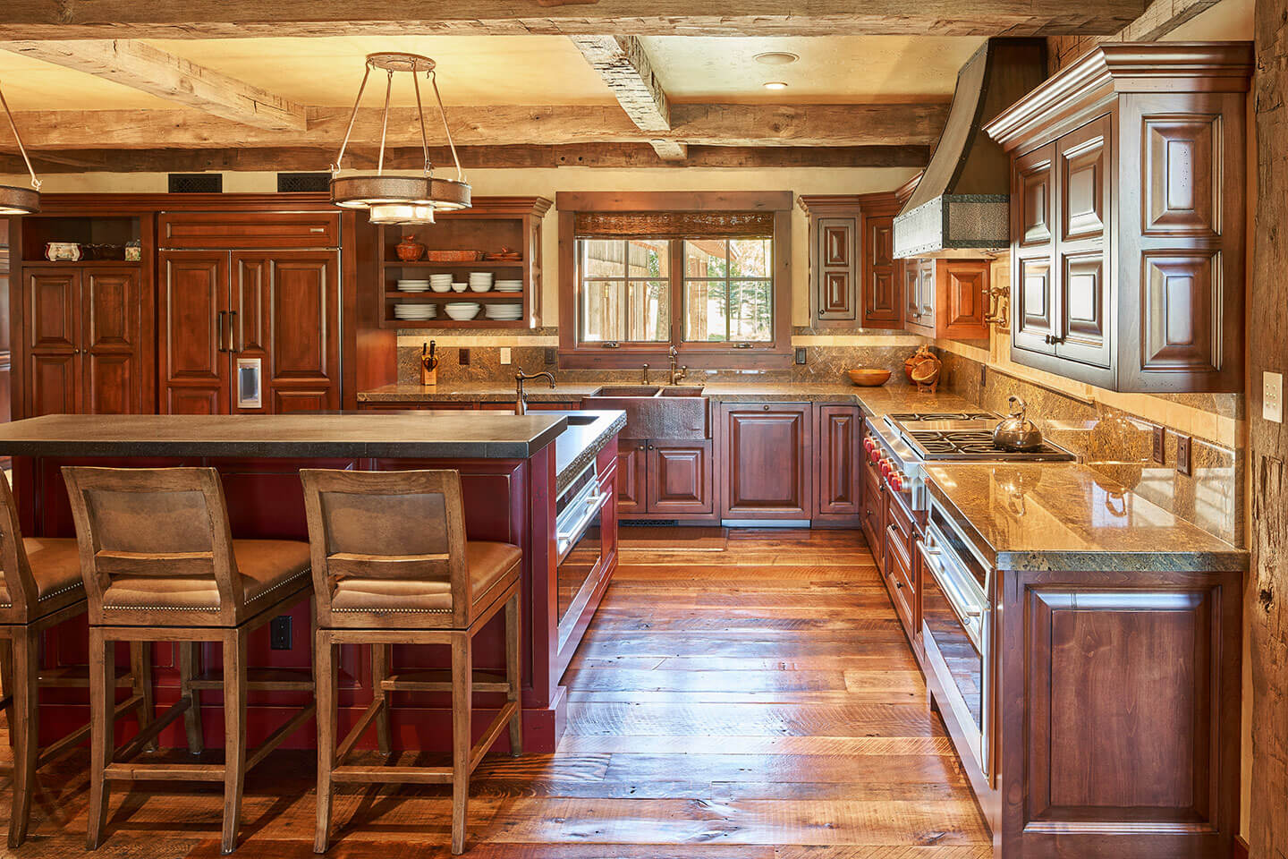 Kitchen with custom-made cherry wood cabinetry