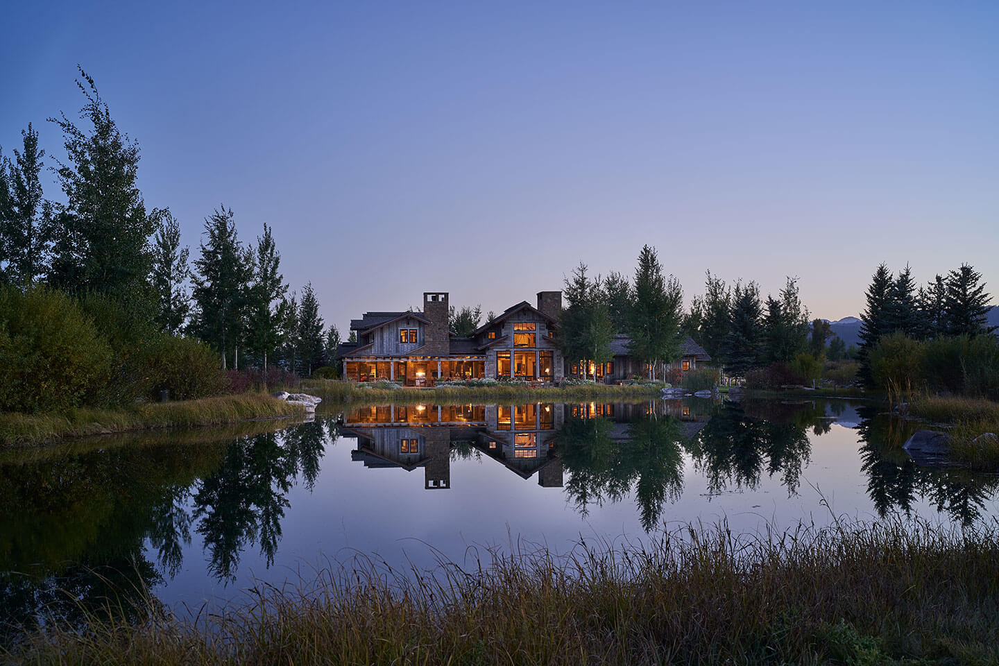 Reflection of residence in water at twilight