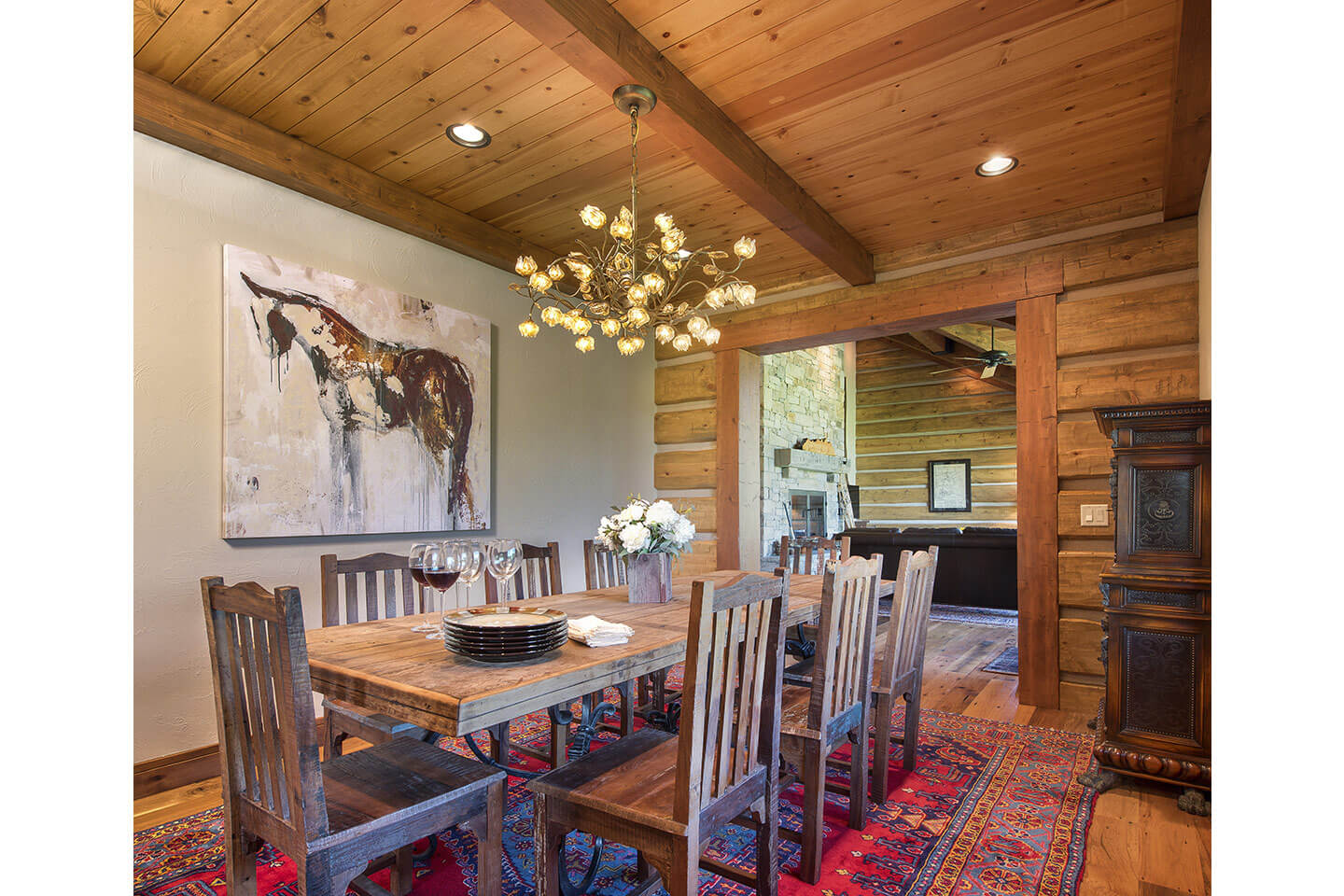 Dining room with log walls and rustic furniture