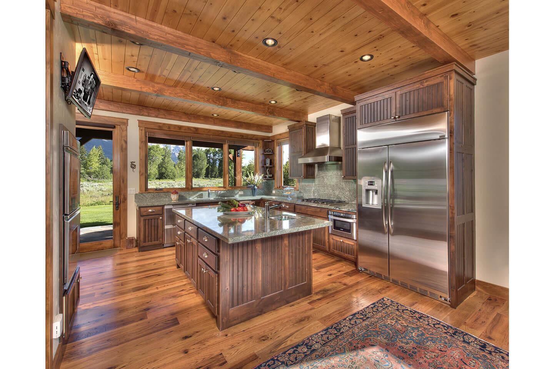 Open floor plan kitchen with numerous windows