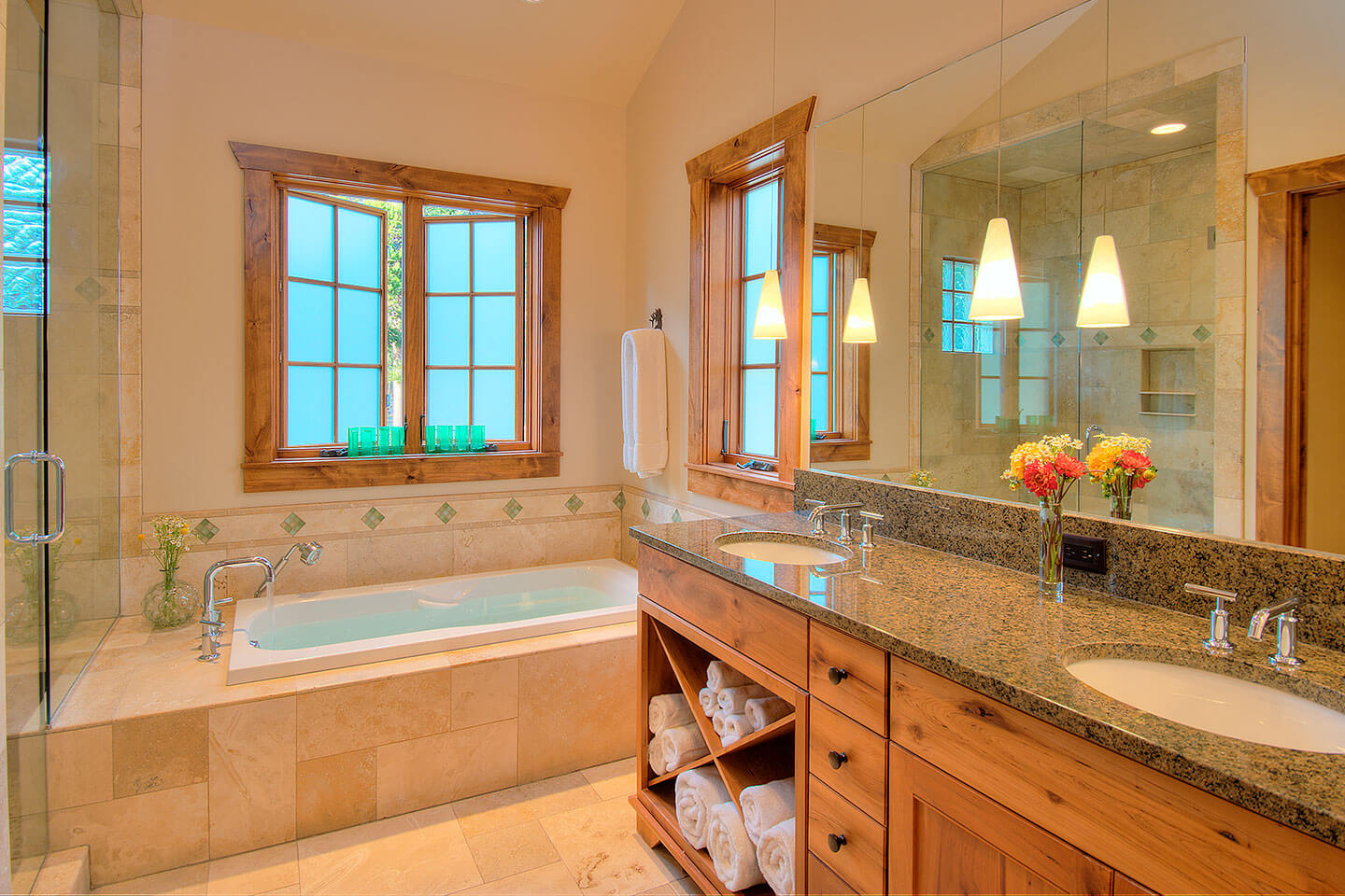 Bathroom with granite counter top and travertine stone
