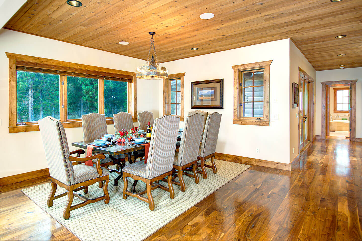 Dining room with wood floor and ceiling