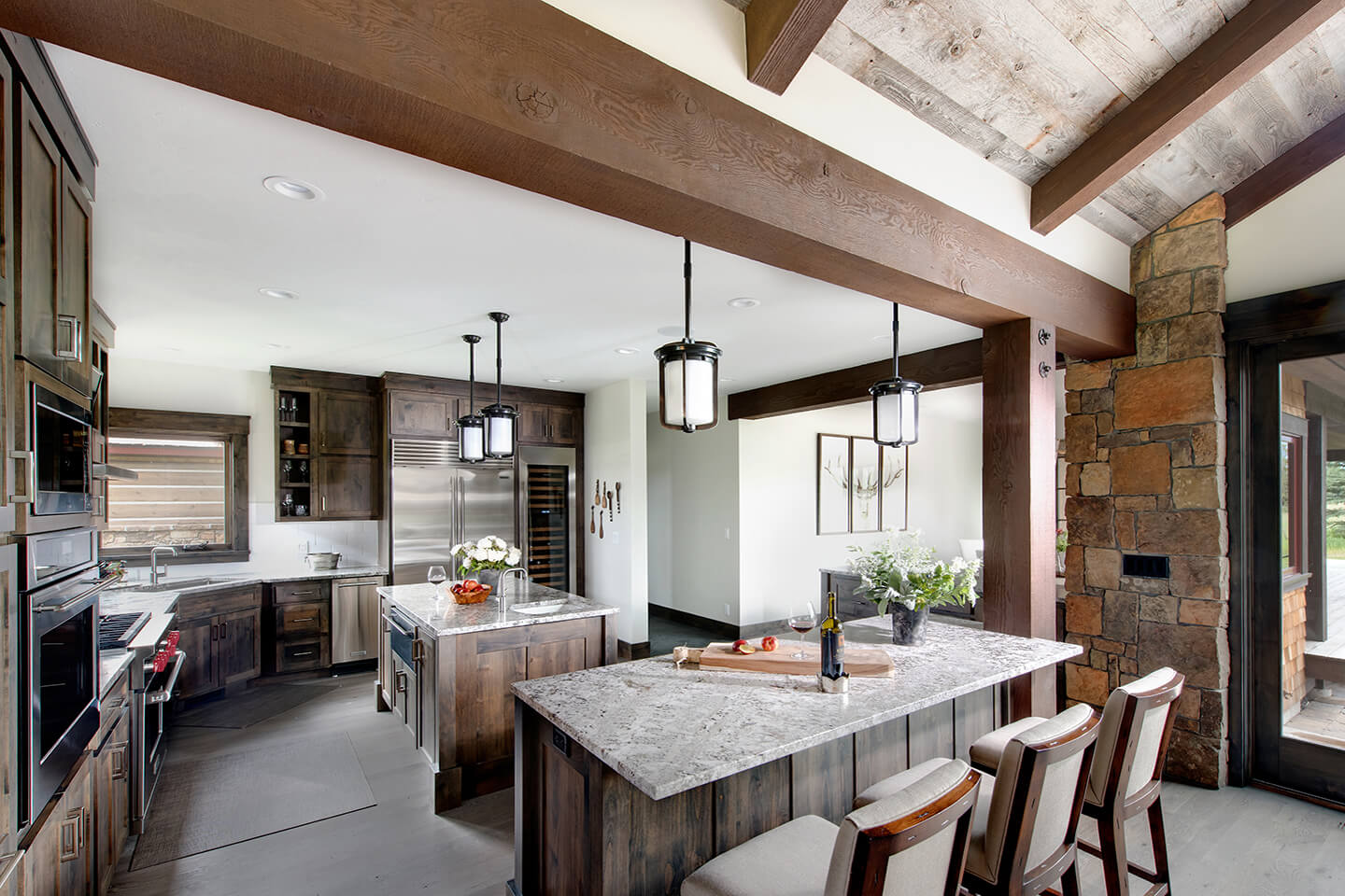 Kitchen with dark stained Douglas fir cabinetry and beams