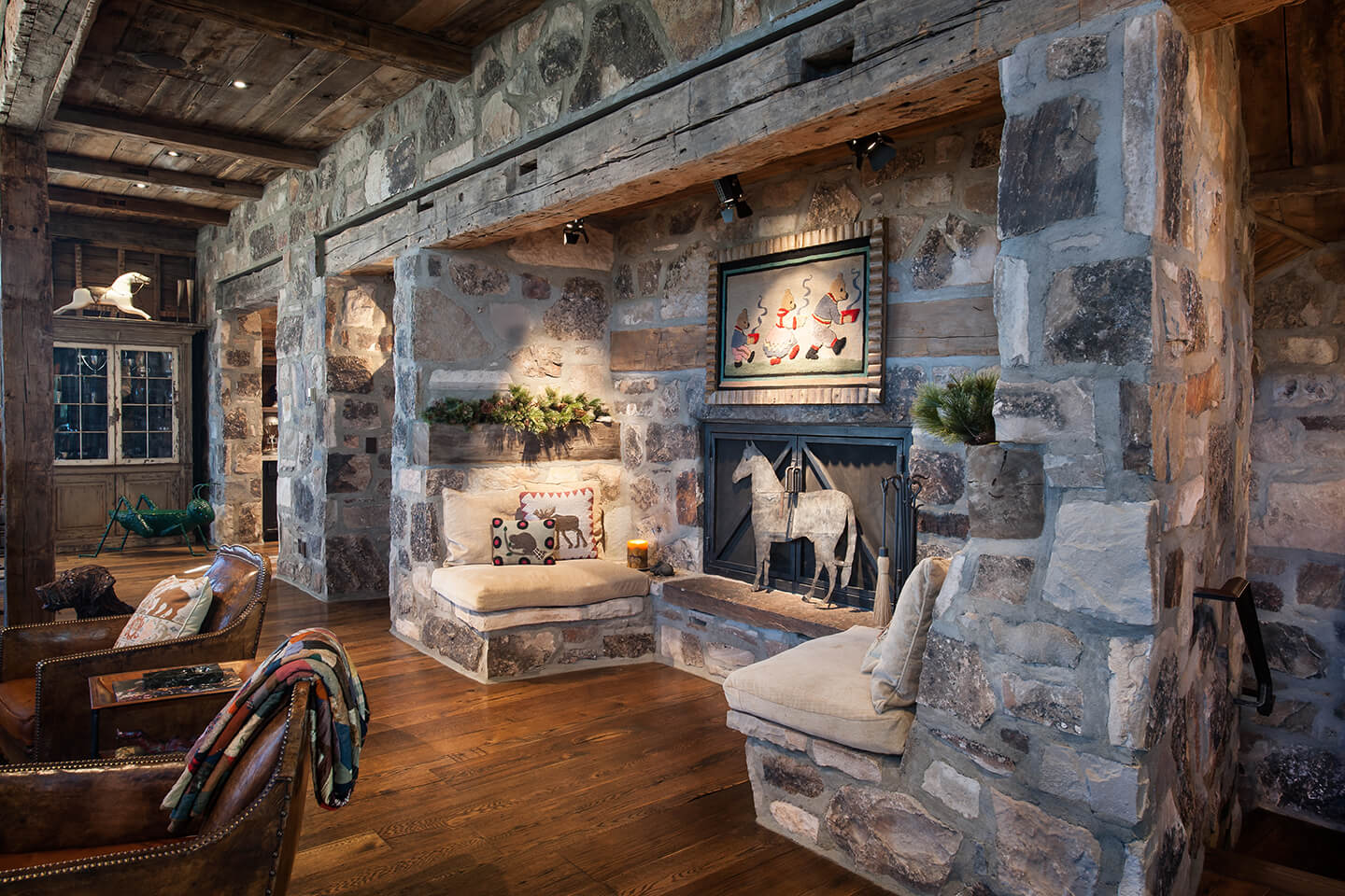 Rustic stone fireplace with a sitting area