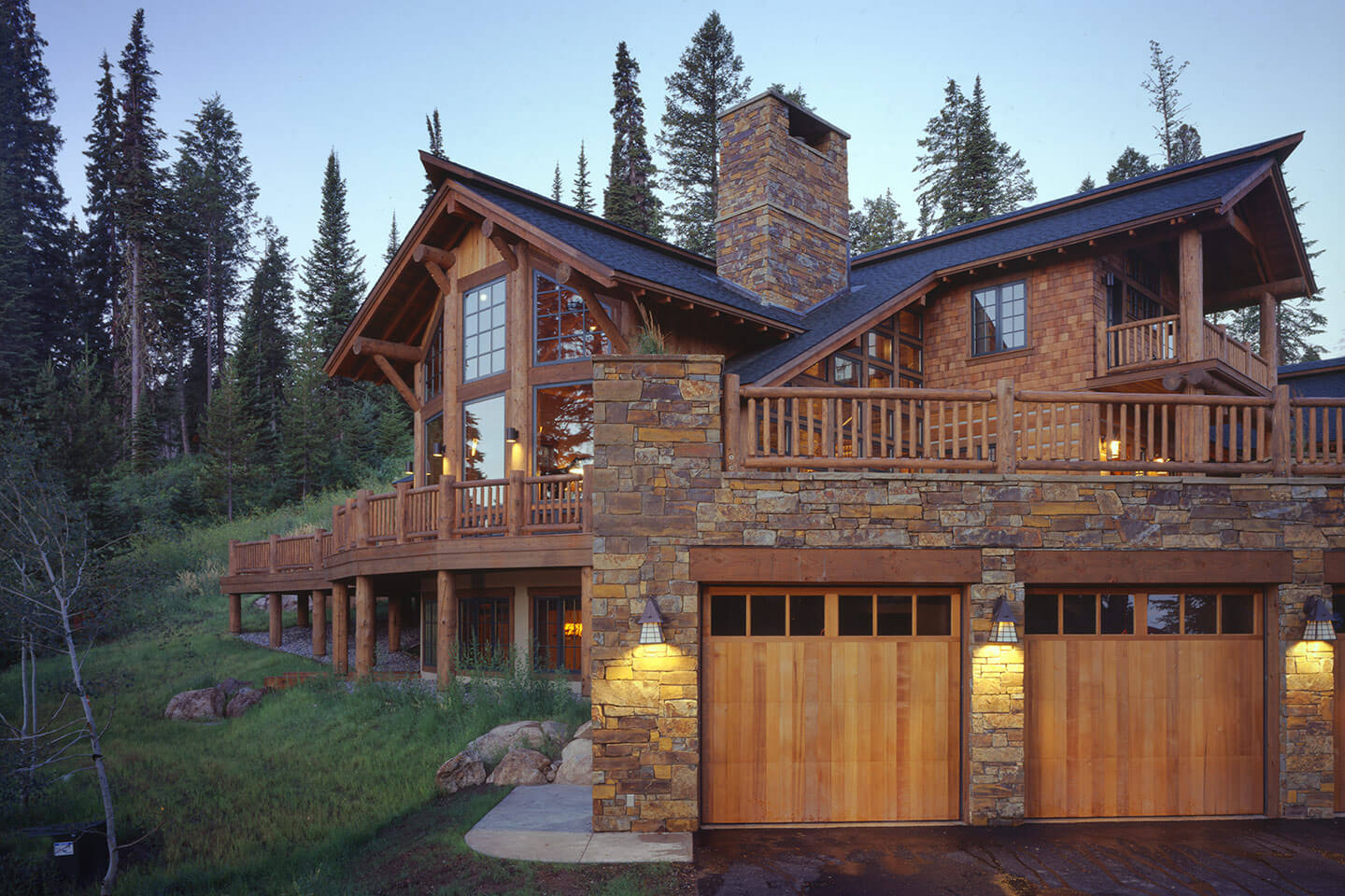 Log home exterior at twilight