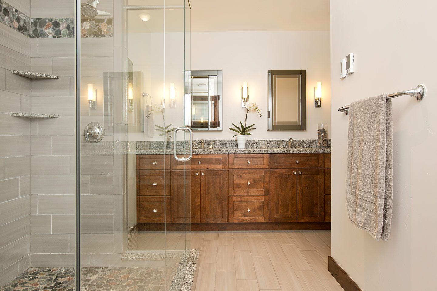 Spacious bathroom with natural stone shower walls