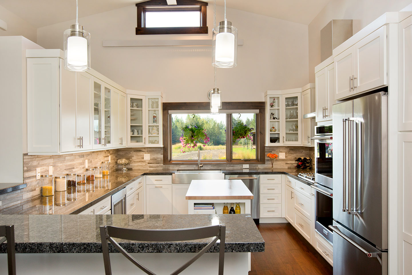 Kitchen with white cabinetry, granite counter top, and stainless steel appliances