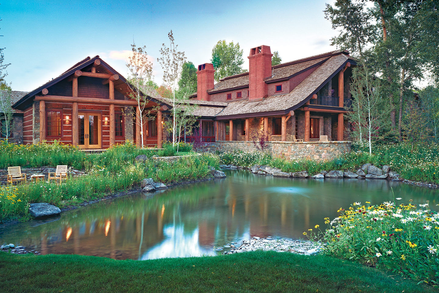 Log home with stone and brick chimneys