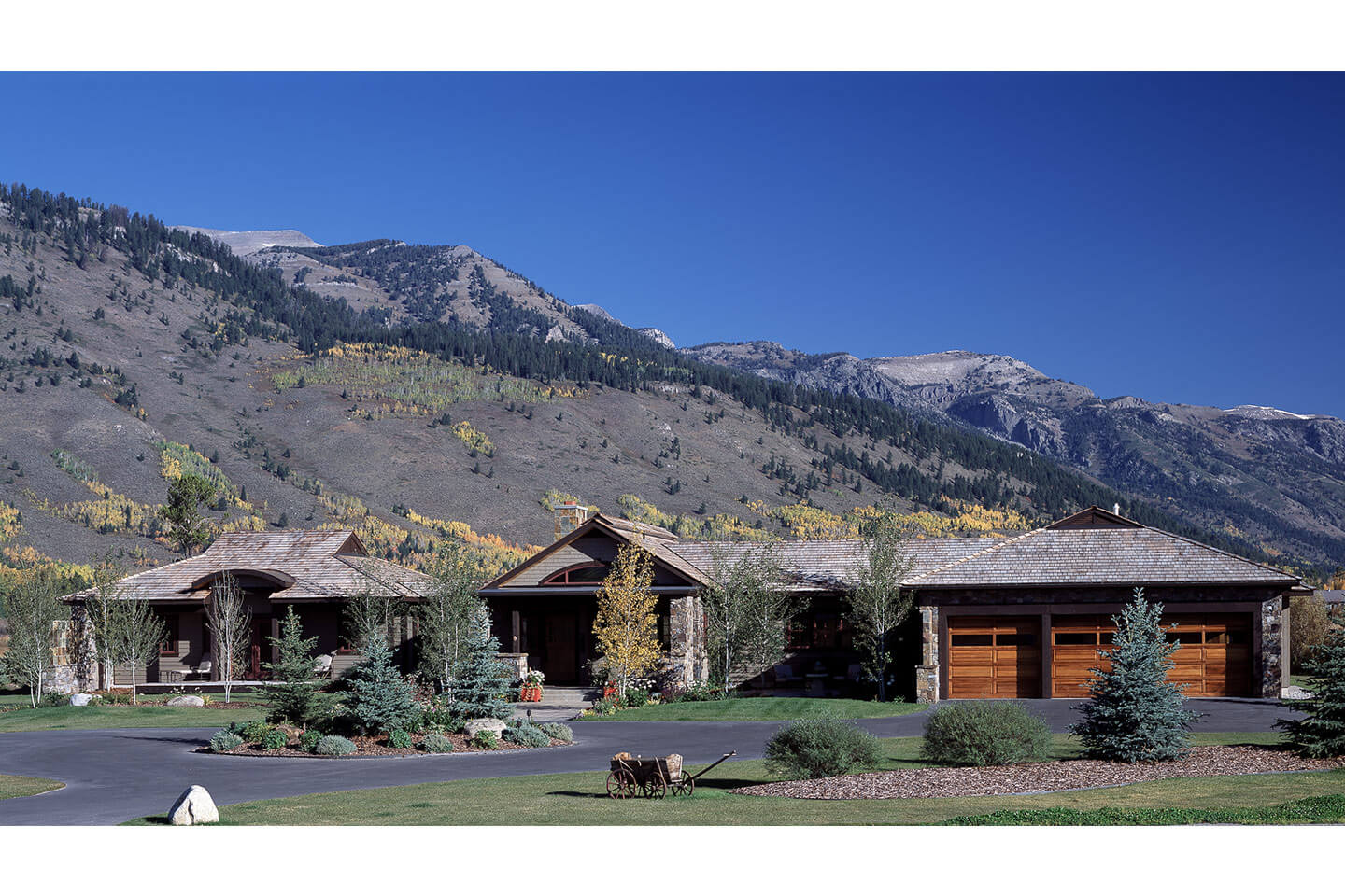 Residence south facade and mountain range in background