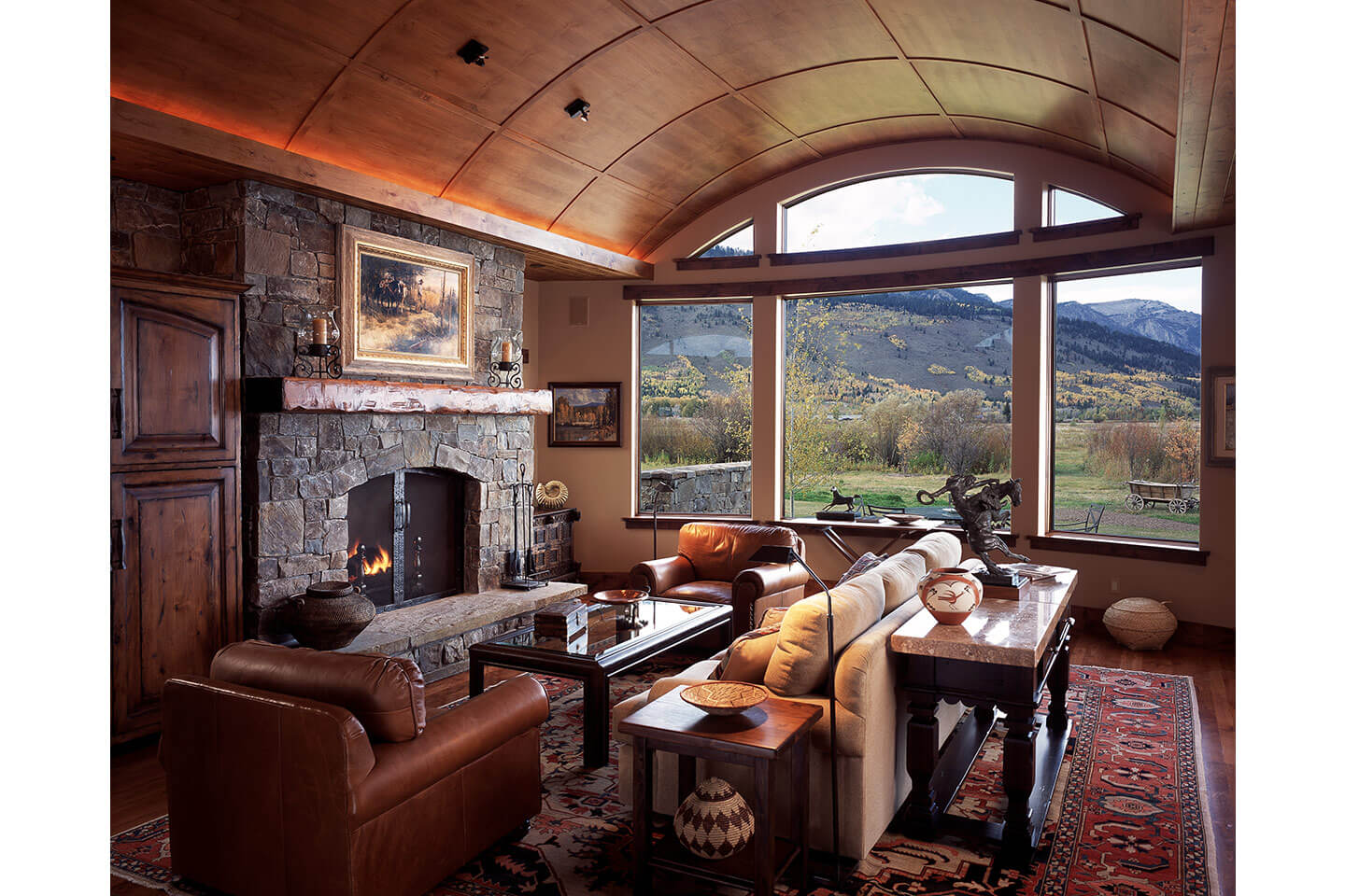 Living room with barrel vaulted ceiling and fireplace