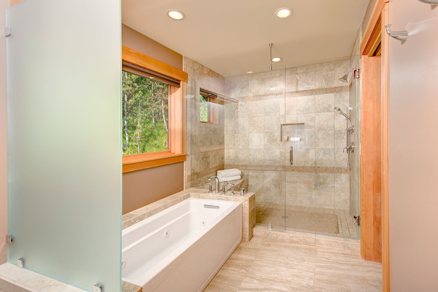 Bathroom with stone and glass elements