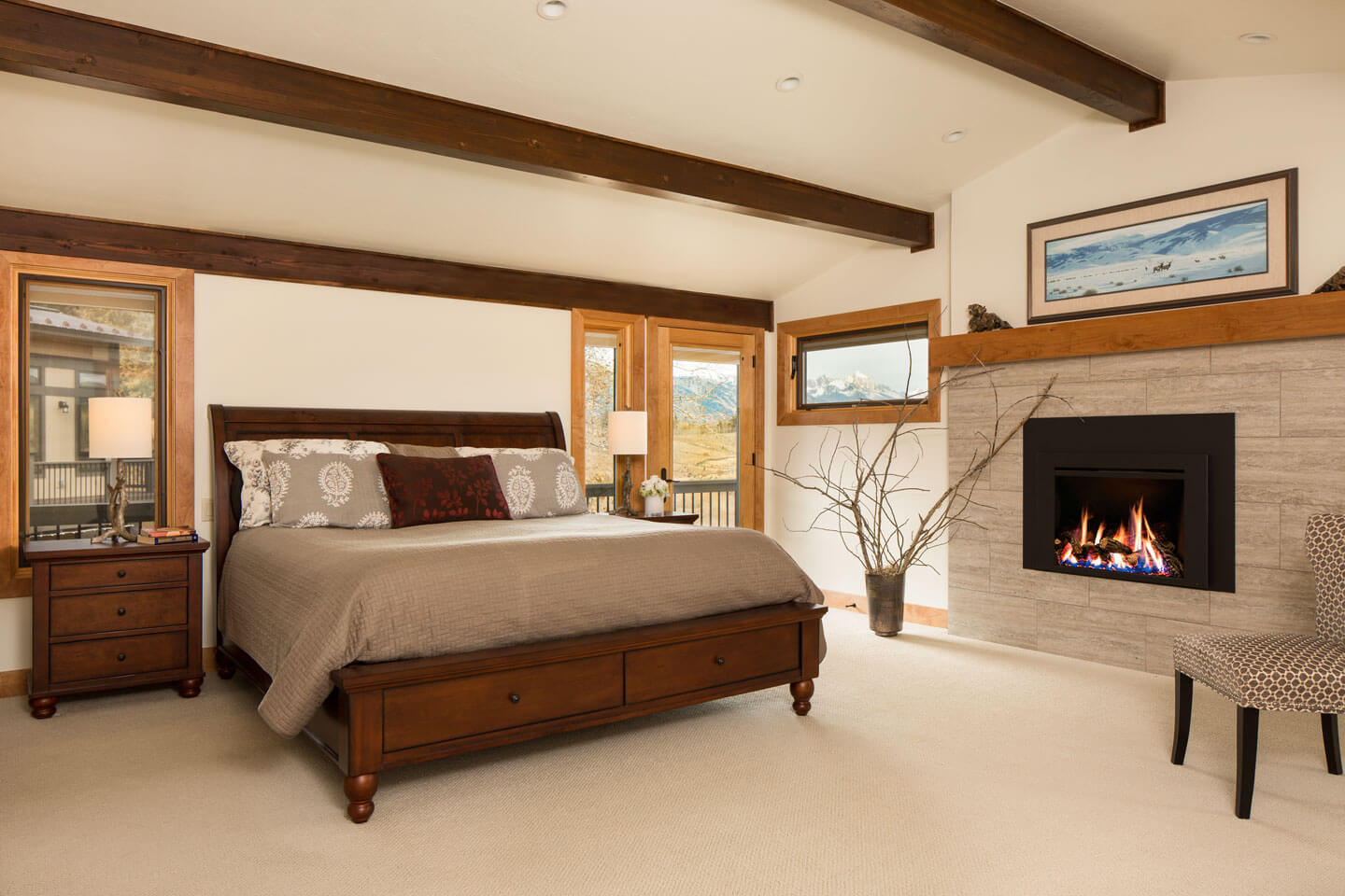 Contemporary master bedroom with enclosed fireplace