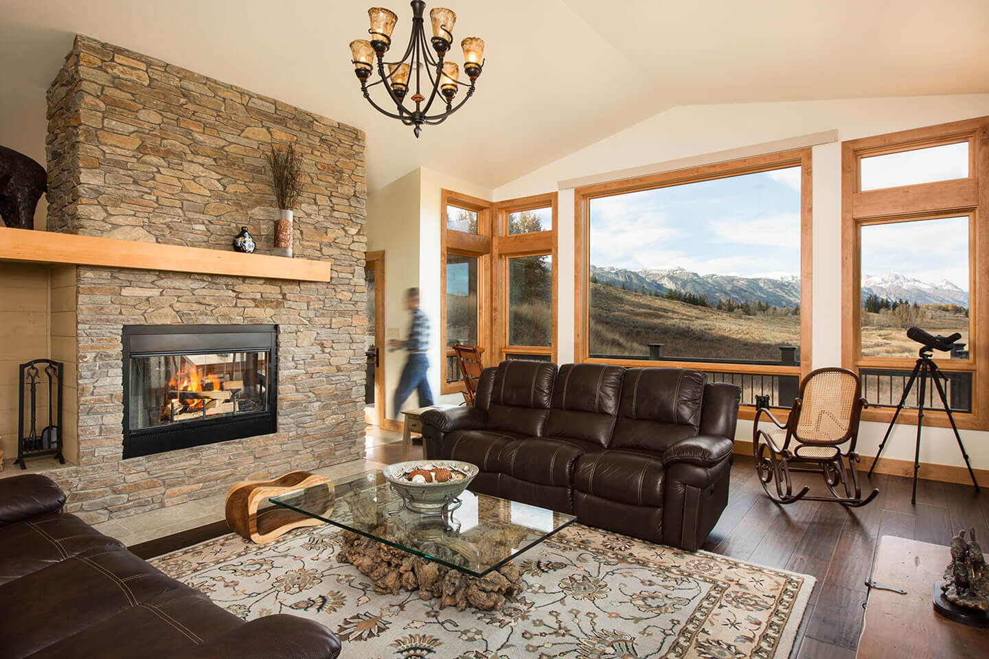 Living room with native stone and view toward the mountain range