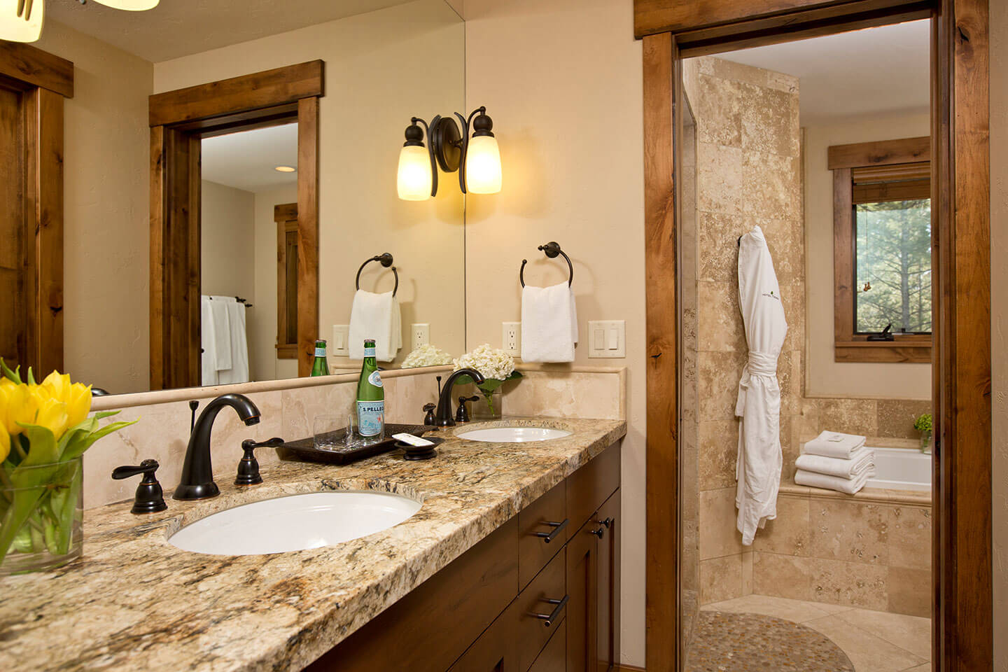 Bathroom with granite counter top and dual sinks