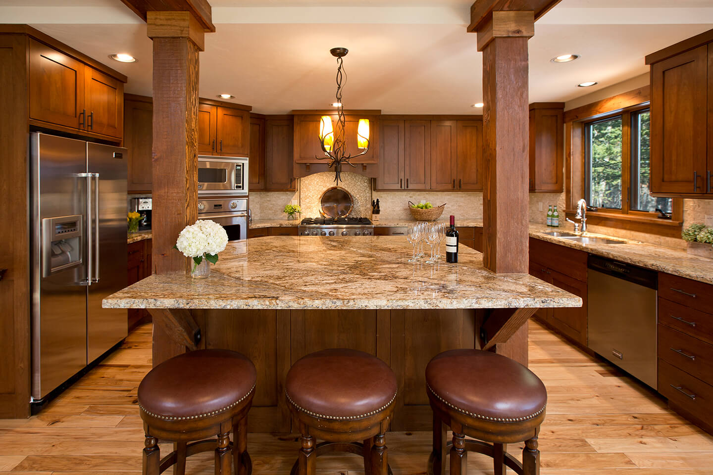 Kitchen with granite counter top and cherry wood cabinetry