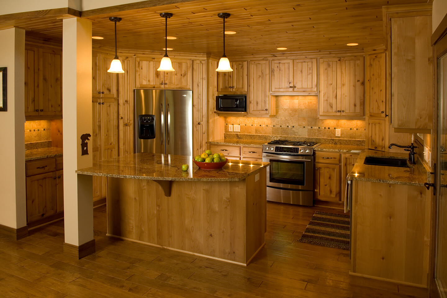 Kitchen with pine wood cabinetry