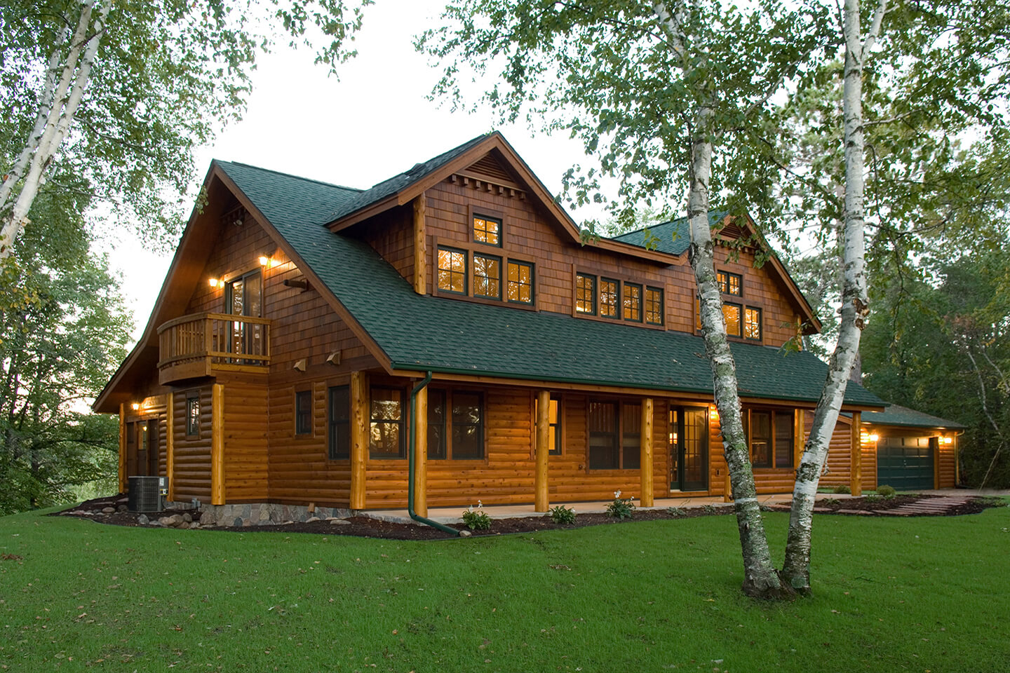 Log home exterior view on entrance side