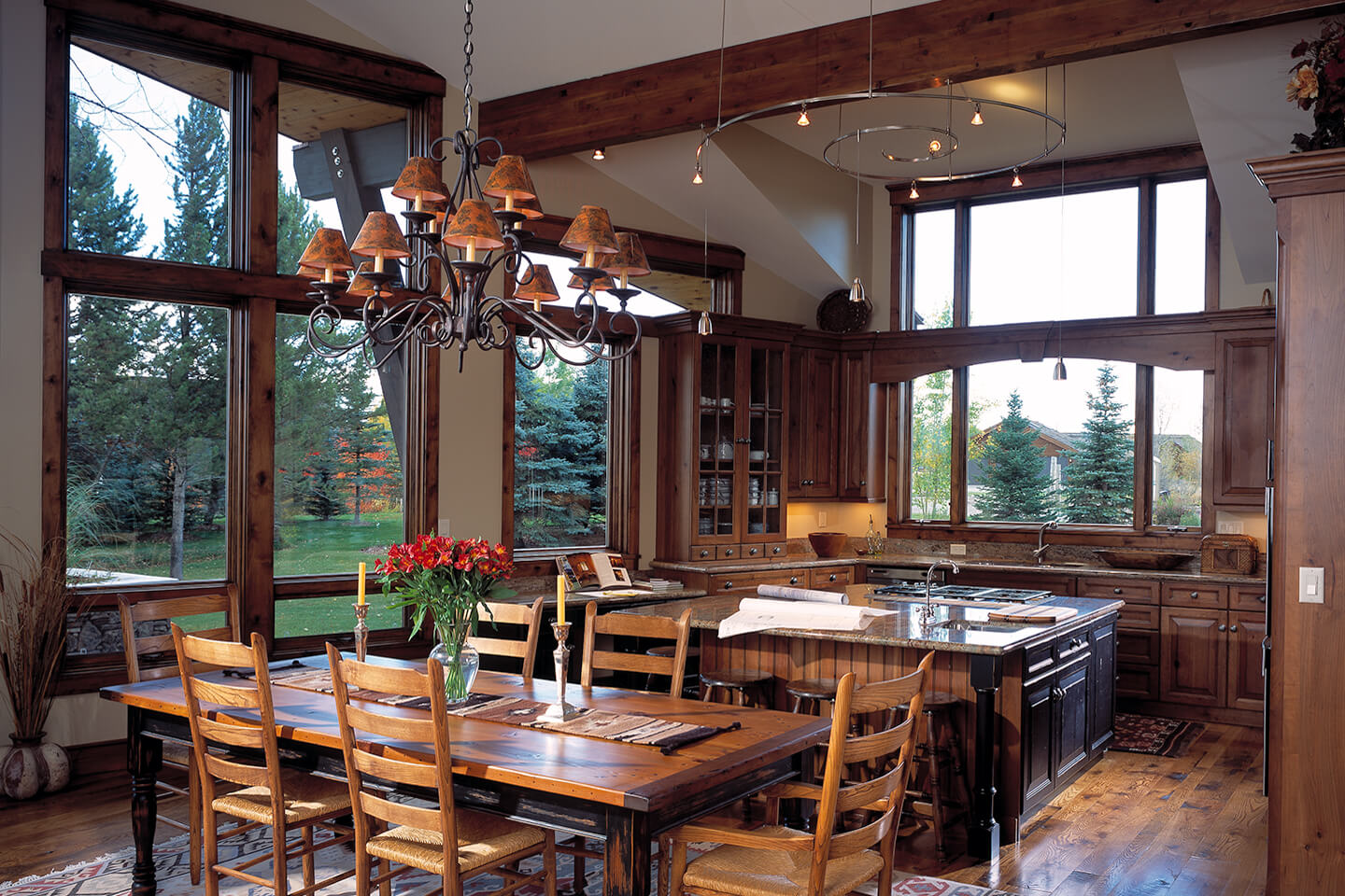 Dining room and kitchen with rustic and modern chandeliers