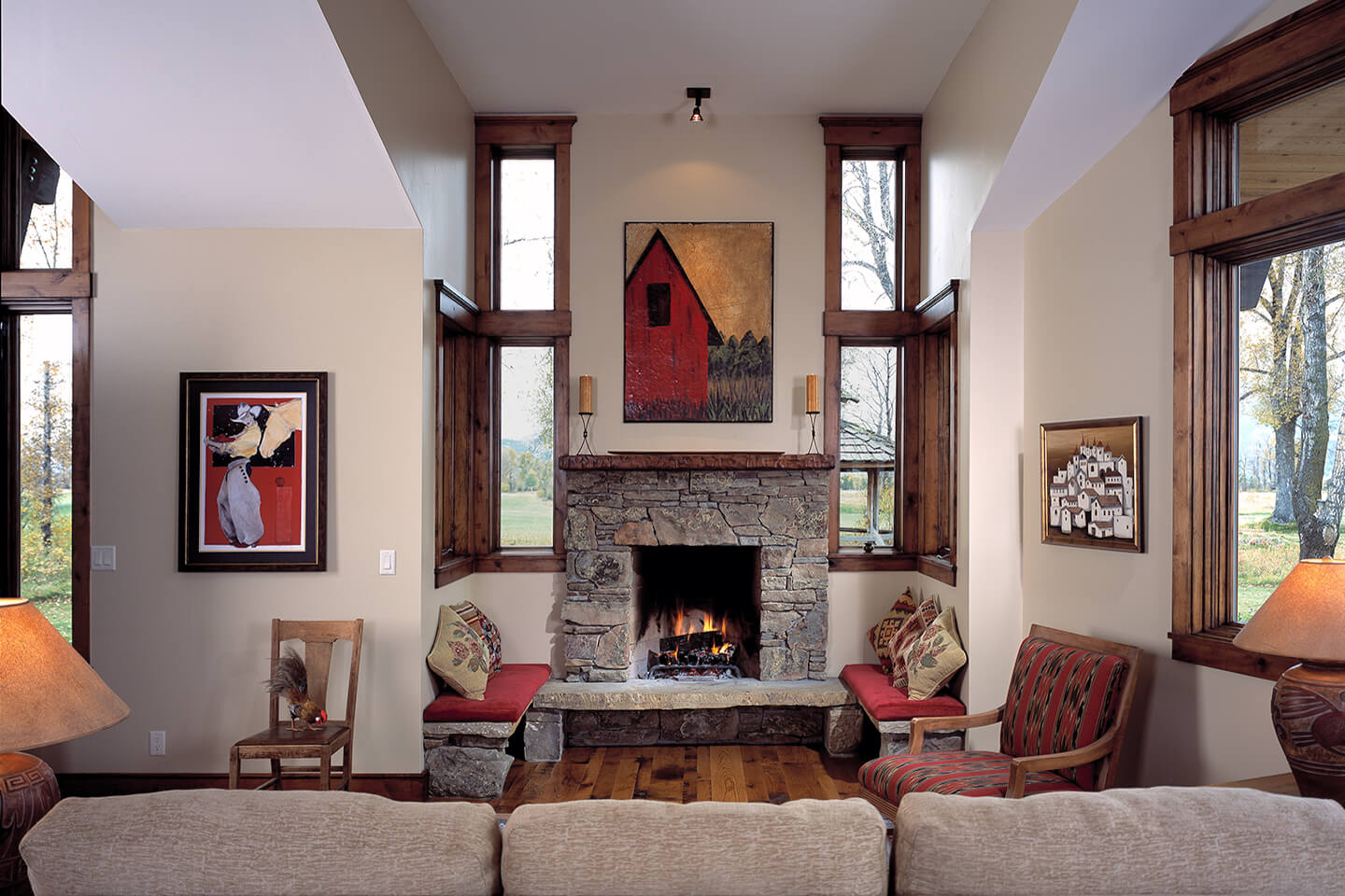 Living room with open hearth fireplace and artwork