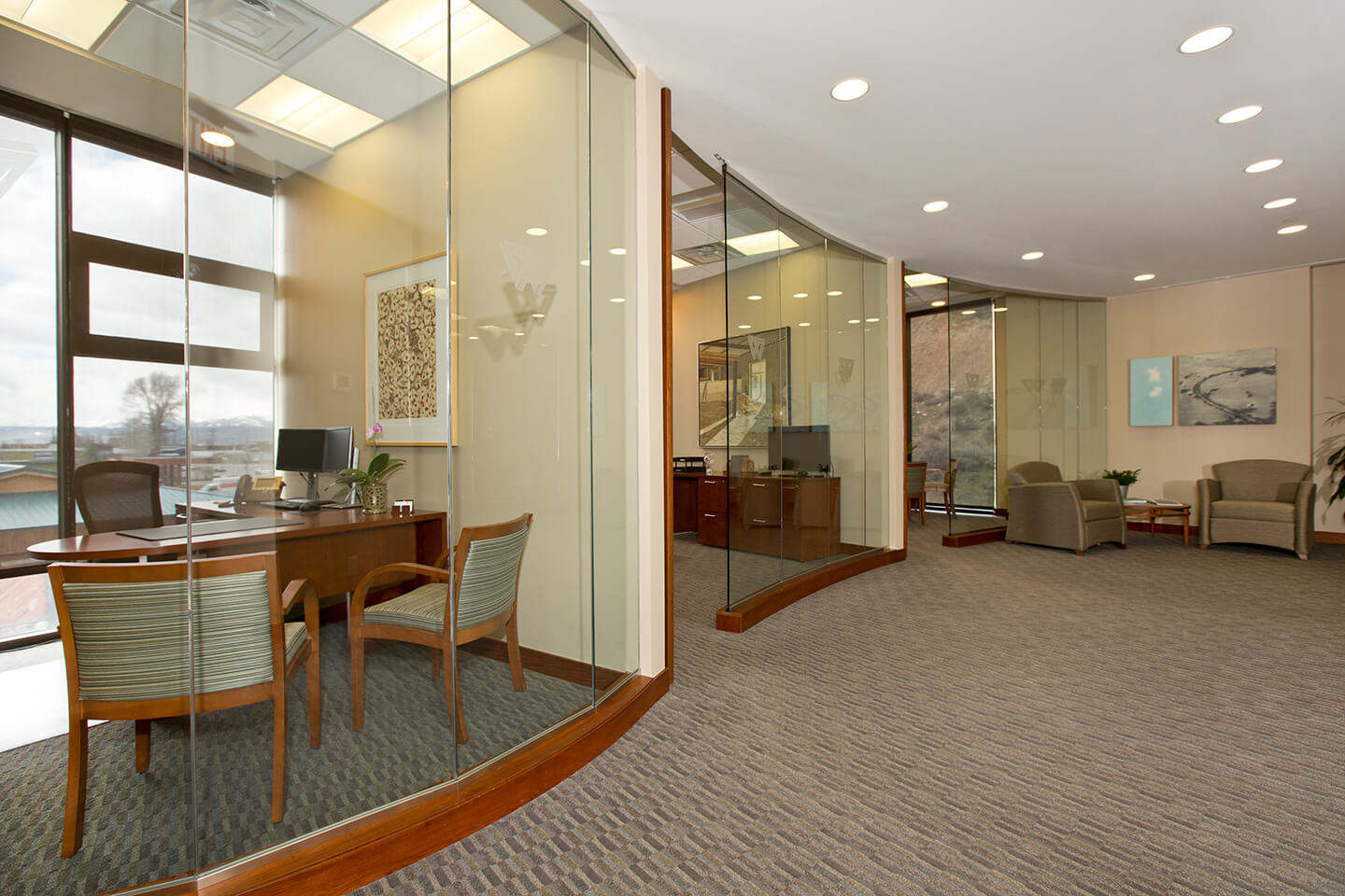 Three offices with curved glass walls