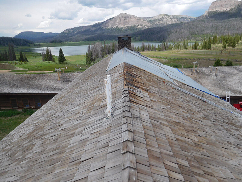 The lodge roof with its temporary cover and the chimney where the fire occurred.