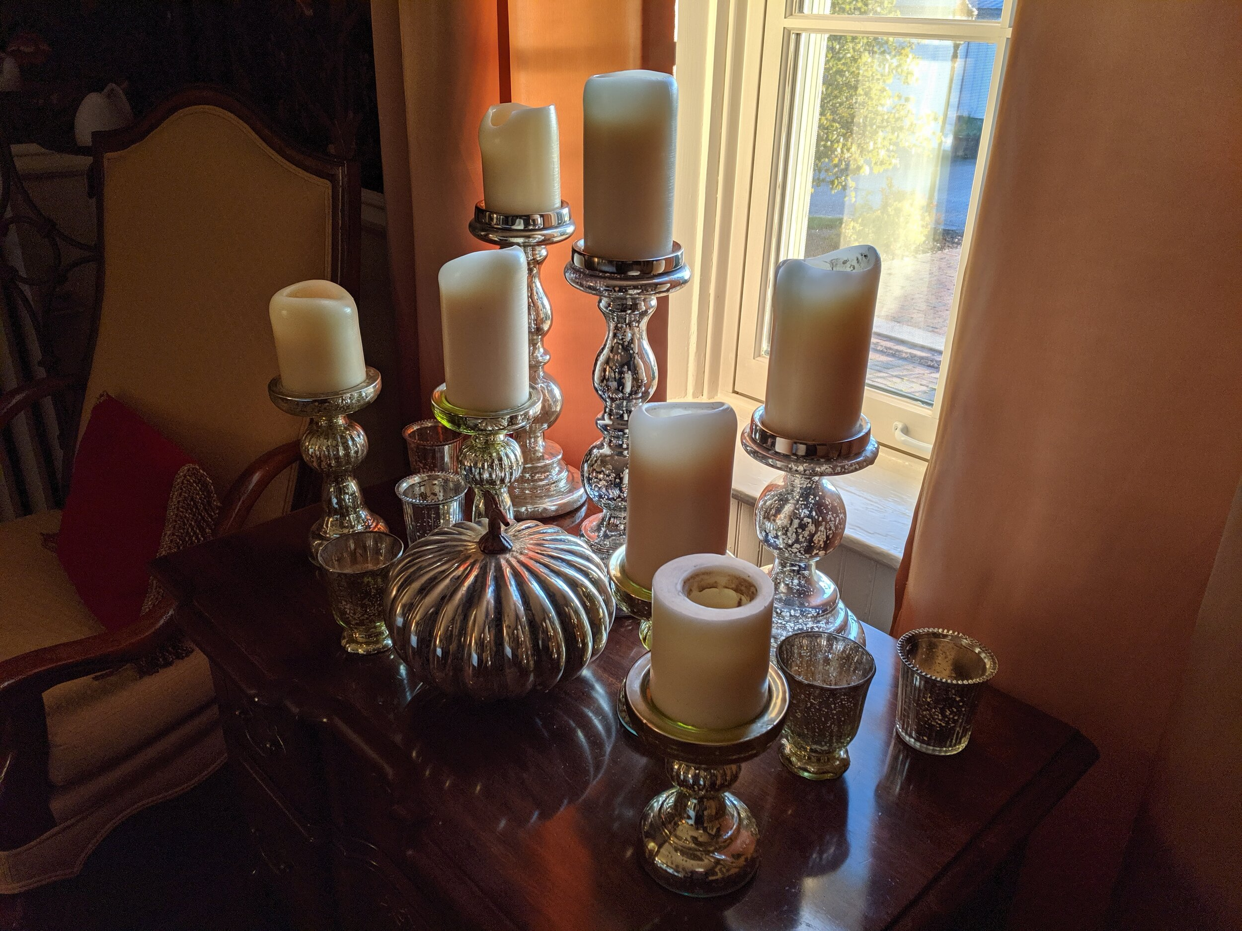 As the days get darker, mercury glass and candles add light to spaces. It's one of Lori's favorite tricks!