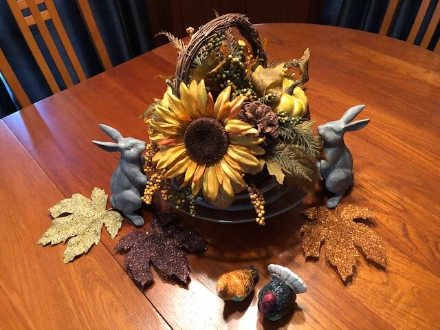 Mary Ellen's fall sunflowers are accented by sparkling leaves and a wicker basket.