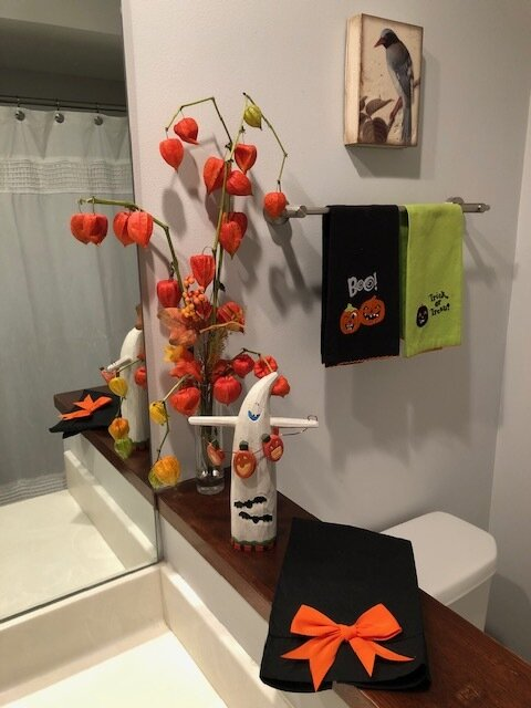 A few stems of orange lantern plant add playful color to Mary Ellen's whimsical Halloween decorations.