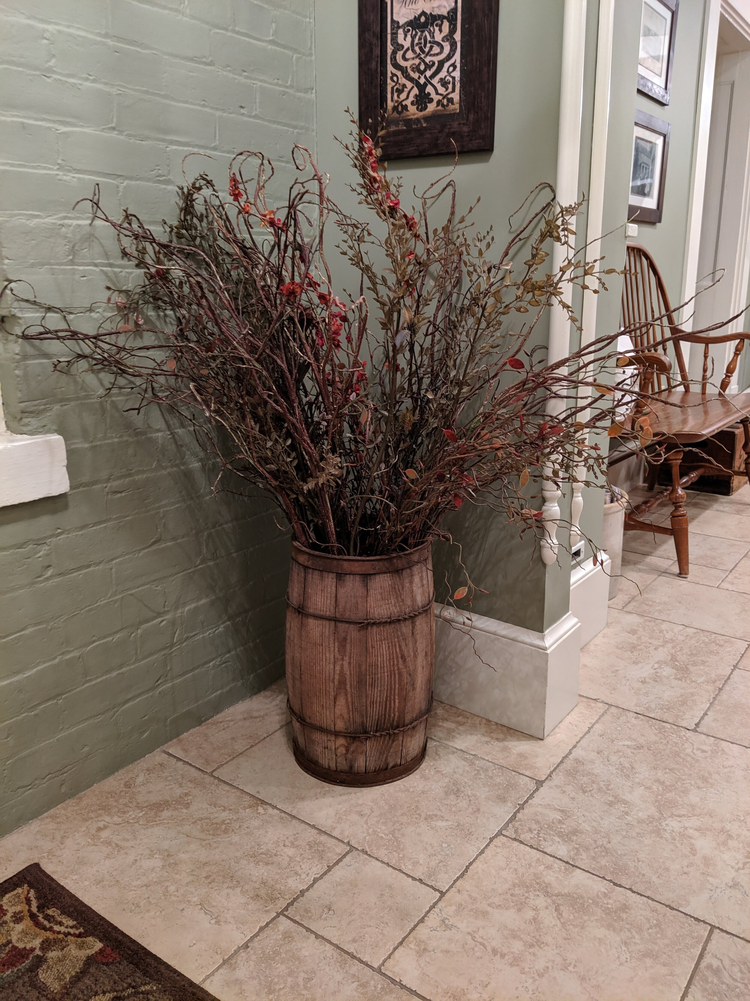 Lori repurposed an old nail keg to hold stems and leaves for fall.