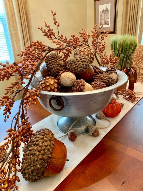 Joan mixes and matches textures, like brushed metal, acorns, and oversized stems, to make things visually interesting.