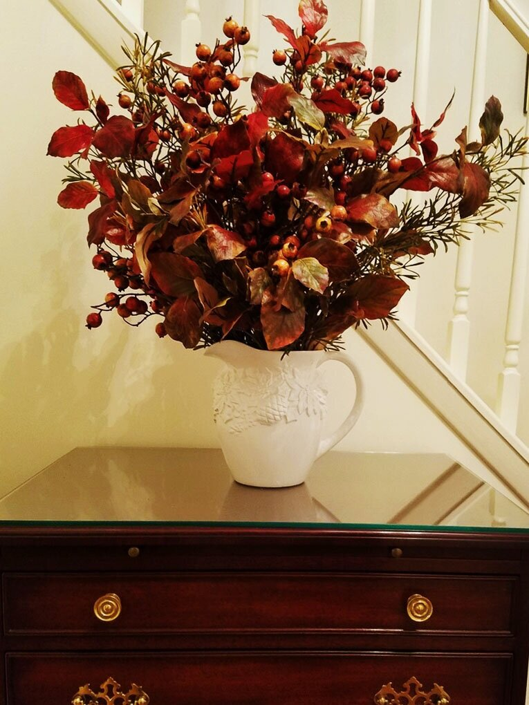 Judy's floral arrangements really shine with fall leaves and warm colors!