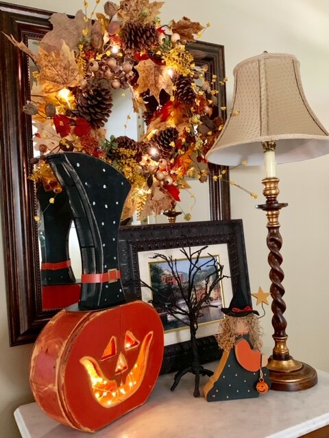 Whimsical Halloween decorations mix well with an autumnal wreath, as Joan shows here.